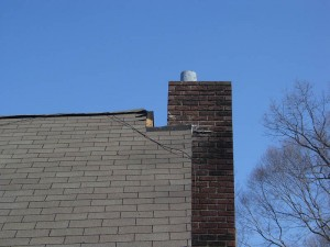 Cracked chimney and roof before repairs