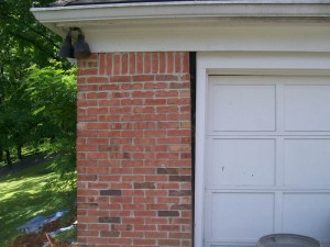 Garage door falling away from brickwork before repairs
